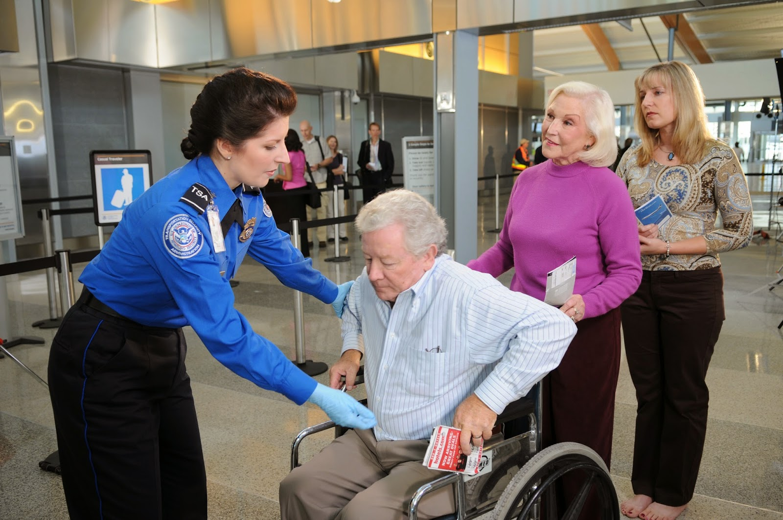 TSA and man in wheelchair