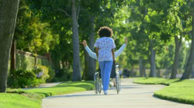 stock-footage-nurse-walking-with-elderly-woman-in-wheelchair